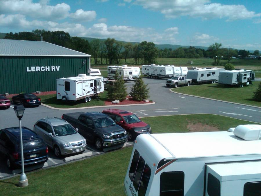 Pictures_-_Front_Of_Lerch_RV's_Building..._You_can_see_the_new_CampingPA.com_(Hooked_to_The_GMC)_Open_Range_Roamer_next_to_one_of_the_Roamers_on_Display....jpg